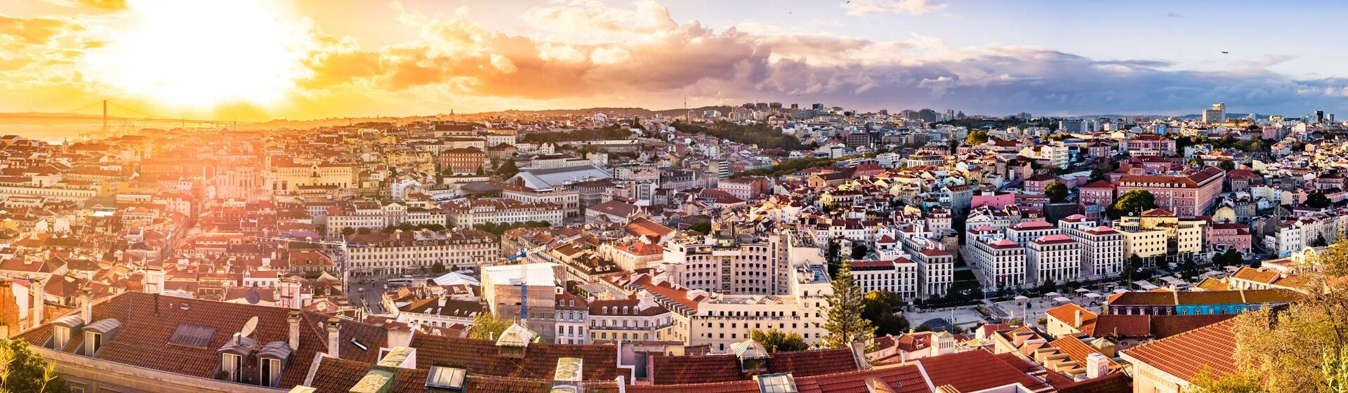 A panorama over the beautiful city of Lisbon, Portugal. The city is situated on seven hills by the water and offers spectacular views and beautiful architecture. The panorama was captured from Castelo Sao Jorge.