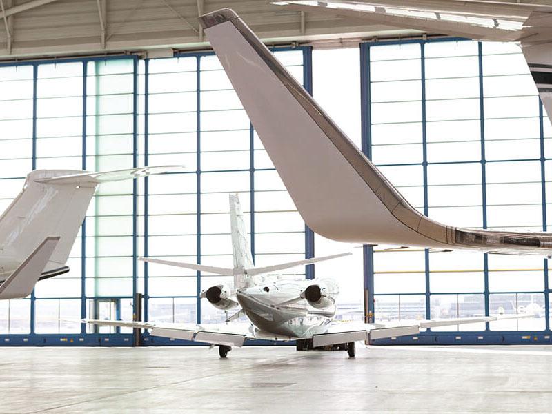 SmallPassengerAirplaneLeavingBrightHangar-1